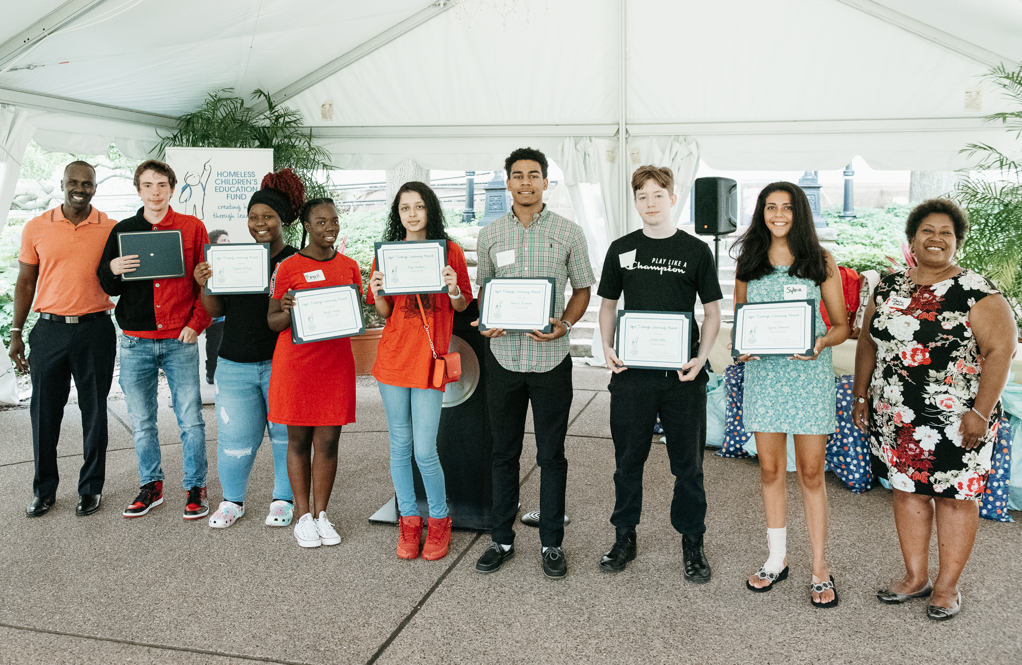 HTLA awardees with their certificates under the outdoor tent at Phipps.